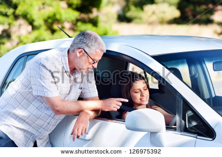stock-photo-driving-instructor-teaching-student-learner-driver-126975392