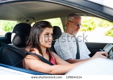 stock-photo-learner-driver-student-driving-car-with-instructor-happy-and-confident-smiling-girl-126644114